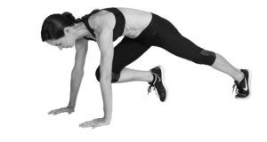 Runner showing the mountain climber exercise