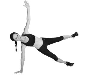 Runner showing the side plank with leg raise exercis